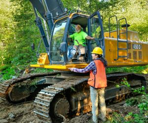 MFWWC Project Manager Audrey Squires discusses the plan with a Haley Construction equipment operator.